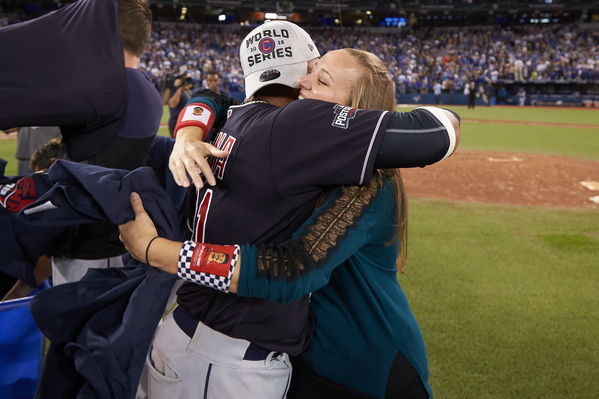 Indians player Carlos Santana and Anna Bolton hug