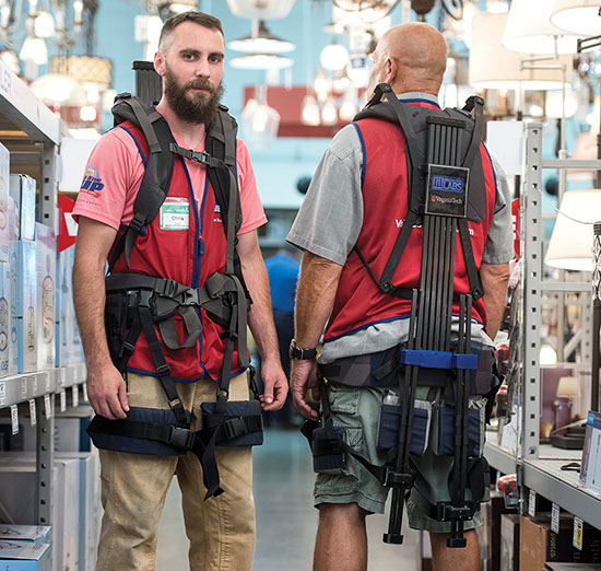 Lowe's employees demostrate the exosuit'